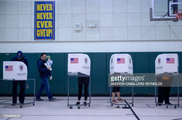 People cast their vote in the Virginia Democratic primary at Emerick Elementary school in Purcellville Virginia on March 3 2020 Fourteen states and...