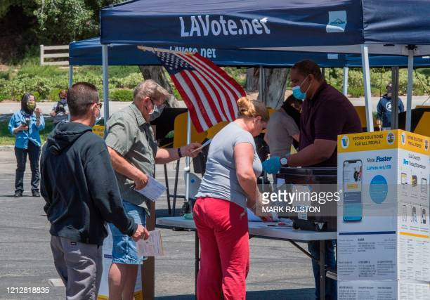 People cast their votes at a polling station for the special election between Democratic state assembly woman Christy Smith and Republican...