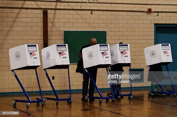 TOPSHOT People cast their votes at a polling station in New York on April 19 2016 New York began voting on April 19 in a highstakes presidential...