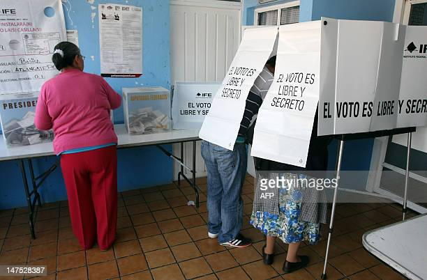 People cast their votes at a polling station in the historic town of Tlaxcala 200 km east of Mexico City on National Election Day on July 1 2012...