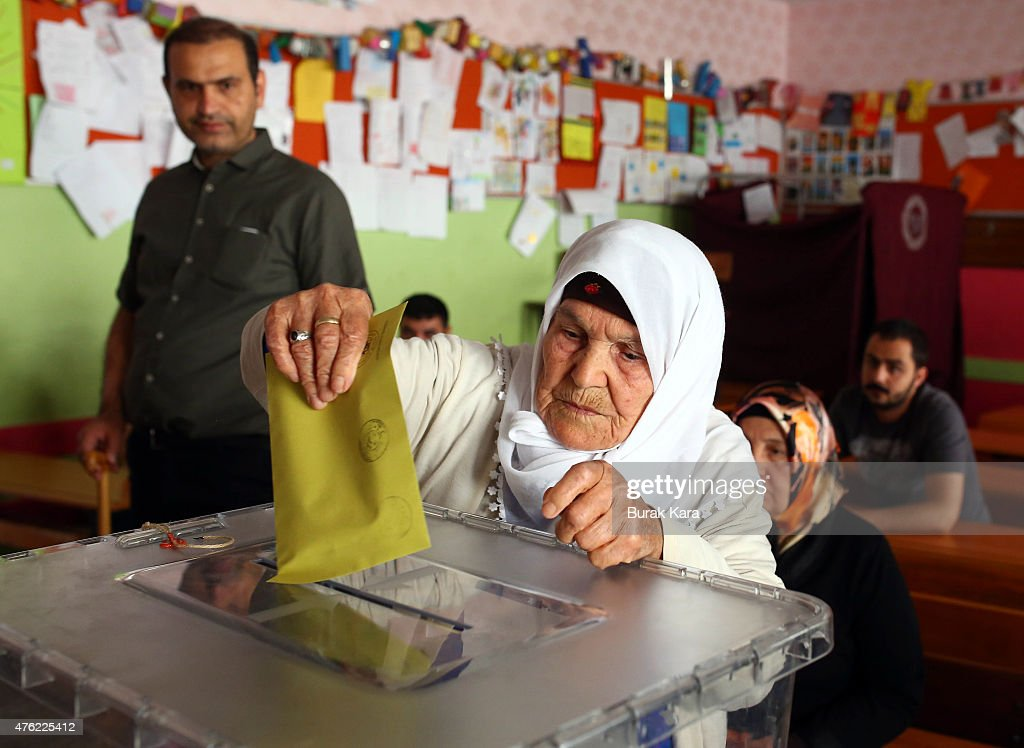 People cast their votes at a polling station polling station on June 7, 2015 in Diyarbakir, Turkey. According to reports some 53 million Turkish people are eligible to vote in the general elections for the 550-seat parliament, with some sources adding that the Kurdish vote, important as Diyarbakir is the traditional heartland of Kurdish Turkey, could be crucial in terms of the ruling AKP's ability to maintain the supermajority it requires to effect constitutional change allocating more powers to the President.