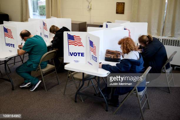 People cast their votes at the Central Trinity United Methodist Church polling location on November 6 2018 in Zanesville Ohio Turnout is expected to...