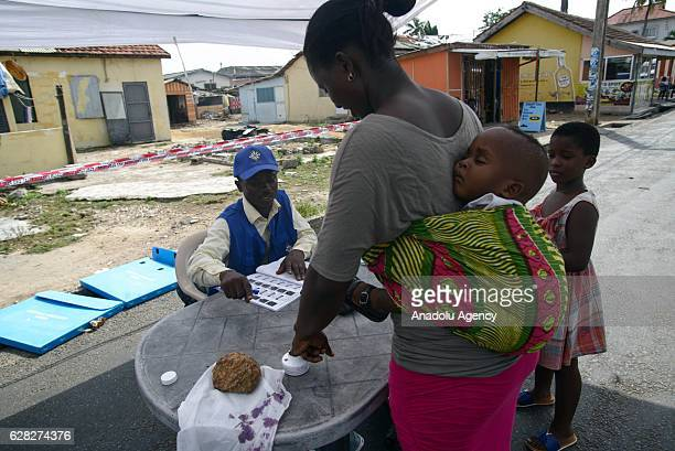 People cast their votes during parliamentary and presidential elections at a Teacher Moto Kindergarten in Osu neighborhood of Accra Ghana on December...