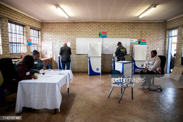 People cast their votes during the sixth general election at Hitekani Primary School in Soweto on May 8 2019 South Africans began voting today in...