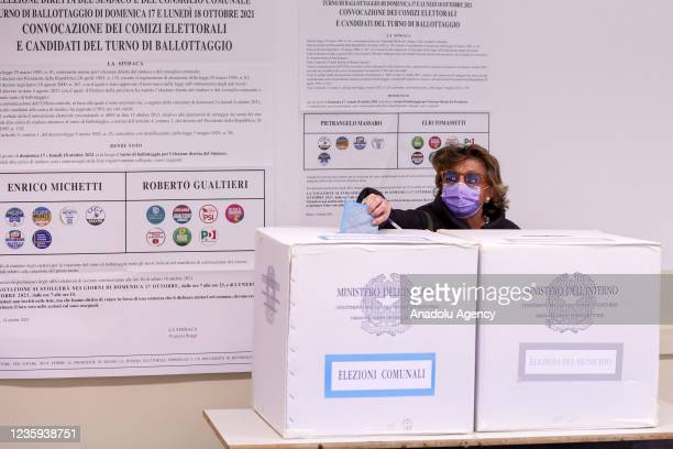 People cast their votes for the runoff elections for mayor at a polling station in Rome, Italy, on October 17, 2021. Rome's citizens vote in a second...