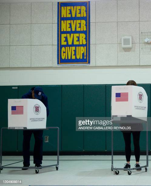 People cast their votes in the Virginia Democratic primary at Emerick Elementary school in Purcellville Virginia on March 3 2020 Fourteen states and...