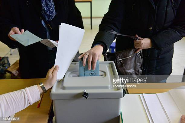People casts their ballots in RhinelandPalatinate state elections on March 13 2016 in Bad Kreuznach Germany State elections taking place today in...