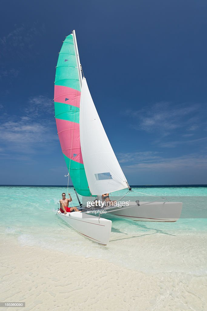 people catamaran beach : Stock Photo
