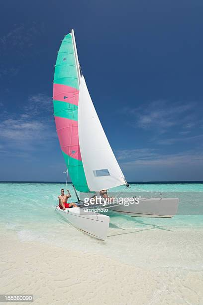 people catamaran beach - catamaran stock photos and pictures