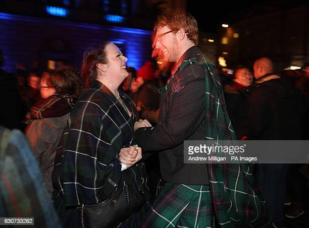 People ceilidh dance on the Royal Mile during the Hogmanay New Year celebrations in Edinburgh