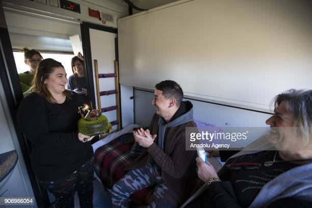 People celebrate a traveler's birthday on the Eastern Express which travels from Ankara to Kars in Ankara Turkey on January 13 2018 With the starting...