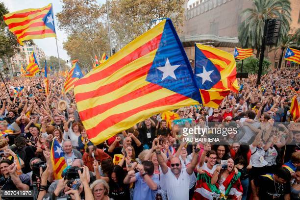 TOPSHOT People celebrate after Catalonia's parliament voted to declare independence from Spain in Barcelona on October 27 2017 Catalonia's parliament...