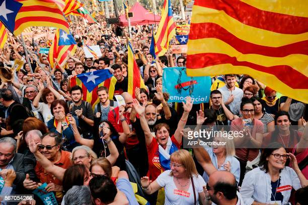 People celebrate after Catalonia's parliament voted to declare independence from Spain on October 27 2017 in Barcelona Catalonia's parliament voted...