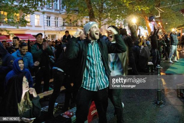People celebrate after Germany scores a late winning goal against Sweden during their 2018 FIFA World Cup match on June 23 2018 in Berlin Germany