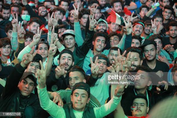 People celebrate after Iraqi Prime Minister Adil AbdulMahdi said he would submit his resignation to parliament within the ongoing antigovernment...