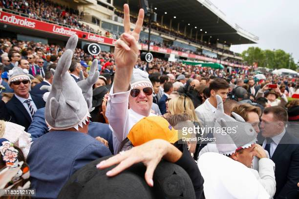 People celebrate after Lys Gracieux wins race 9 the Ladbrokes Cox Plate during Cox Plate Day at Mooney Valley Racecourse on October 26, 2019 in...