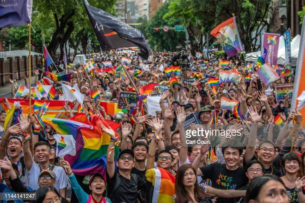 People celebrate after Taiwan's parliament voted to legalise samesex marriage on May 17 2019 in Taipei Taiwan Taiwan became the first country in Asia...