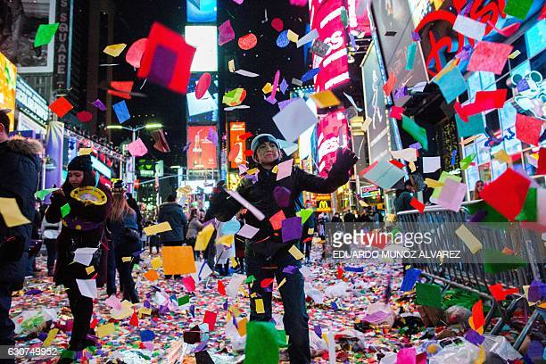 People celebrate after taking part in the New Year's eve at Times Square on January 1 2017 in New York / AFP / EDUARDO MUNOZ ALVAREZ