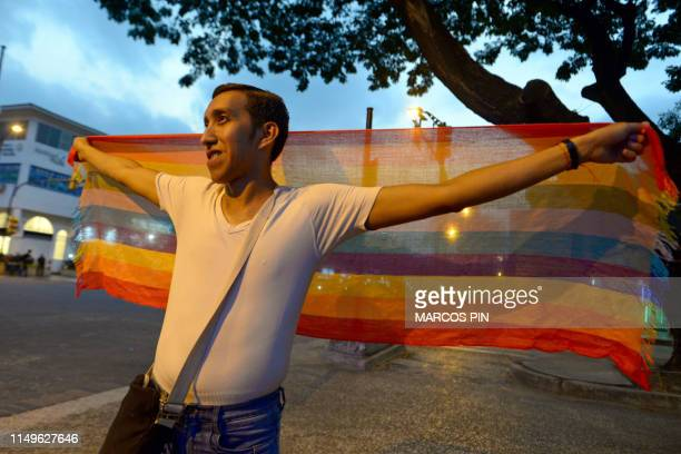 People celebrate after the Ecuador's Constitutional Court approved equal civil marriage, in Guayaquil, Ecuador on June 12, 2019. - Ecuador's highest...