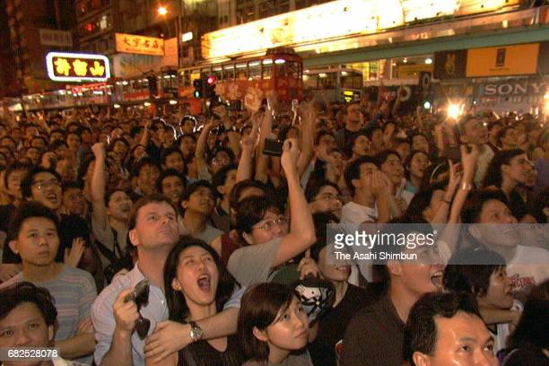 People celebrate after the handover on July 1 1997 in Hong Kong