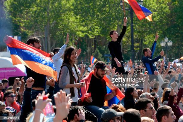 People celebrate after the release of the leader of Armenia's mass antigovernment protests Nikol Pashinyan in Yerevan on April 23 2018