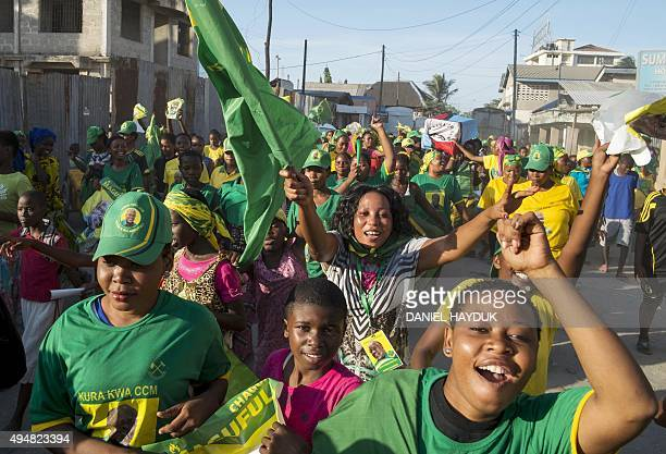 People celebrate after the ruling party Chama Cha Mapinduzi candidate John Magufuli was named presidentelect by the National Electoral Commission in...
