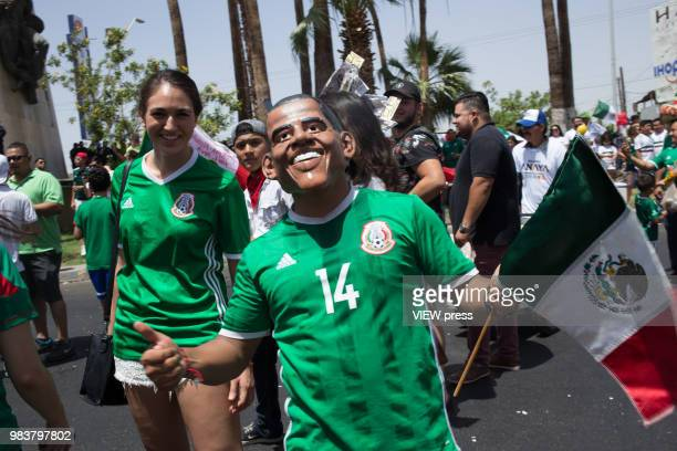 People celebrate after winning their FIFA World Cup Group F South Korea vs Mexico match on June 23 2018 in Mexicali Mexico