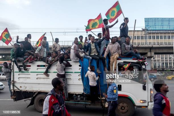 People celebrate ahead of the return of a formerly banned antigovernment group the Oromo Liberation Front in the Ethiopian capital Addis Ababa on...