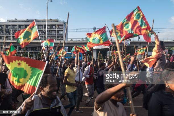 People celebrate ahead of the return of the formerly banned antigovernment group the Oromo Liberation Front in the Ethiopian capital Addis Ababa on...