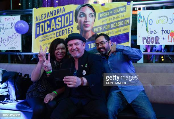 People celebrate Alexandria OcasioCortez congressional race big win during her election night party in the Queens Borough of New York on November 6...