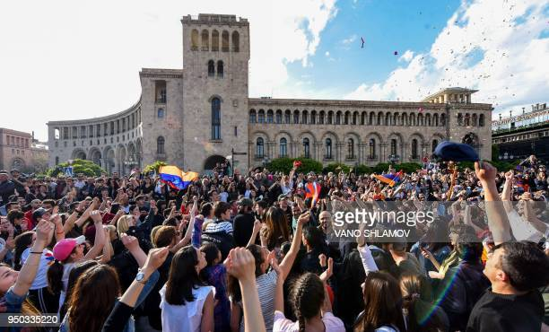 TOPSHOT People celebrate Armenian prime minister Serzh Sarkisian's resignation in downtown Yerevan on April 23 2018 Armenia's veteran leader Serzh...