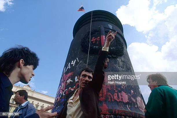 People celebrate around the pedestal where a statue of KGB founder Feliks Dzerzhinsky was taken down after a 1991 failed coup attempt The State...