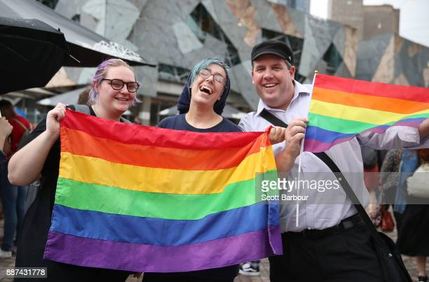 People celebrate as a crowd gathers to watch a large television screen at Federation Square as it is announced that samesex marriage will be legal in...