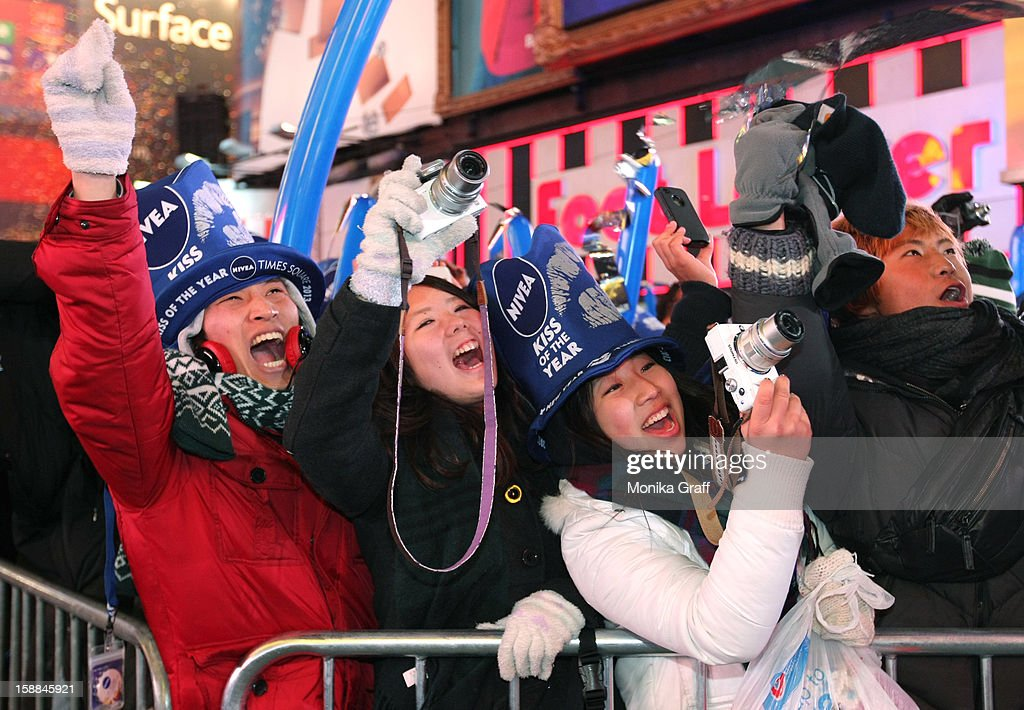 People celebrate as the stroke of midnight rings in the new year in Times Square on January 1, 2013 in New York City. Approximately one million people are expected to ring in the new year in Times Square.