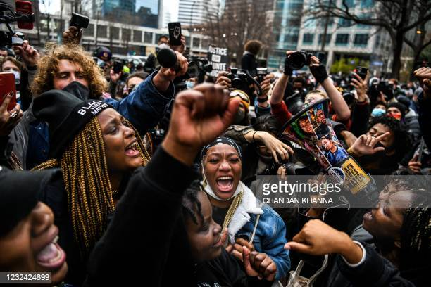 People celebrate as the verdict is announced in the trial of former police officer Derek Chauvin outside the Hennepin County Government Center in...