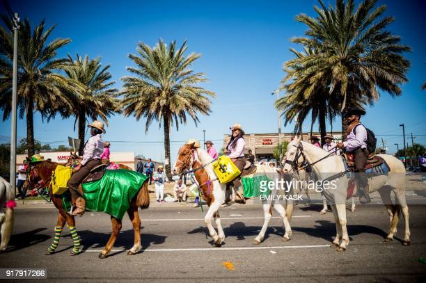 People celebrate as the Zulu Parade runs through New Orleans on Mardi Gras February 13 2018 / AFP PHOTO / 00059360A / Emily Kask