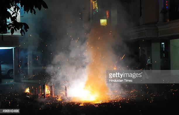 People celebrate as they burst crackers on the occasion of Diwali the festival of Lights on November 11 2015 in Bhopal India Diwali is an ancient...