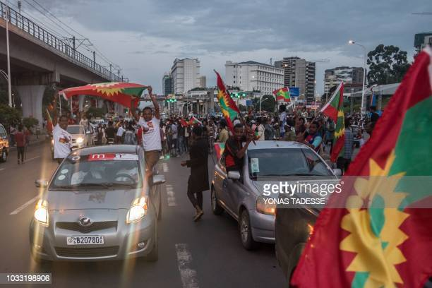 People celebrate as they wave the Oromo flag ahead of the return of a formerly banned antigovernment group the Oromo Liberation Front in the...