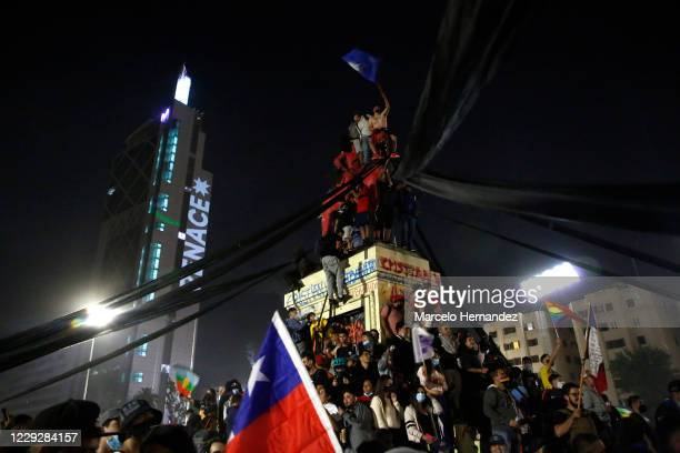 People celebrate as waiting for the official results of the referendum for a new constitution on October 25, 2020 in Santiago, Chile. The approval...