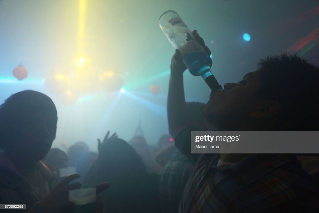 People celebrate at a nightclub in the early morning hours on November 5, 2017 in Ushuaia, Argentina. Ushuaia is situated along the southern edge of Tierra del Fuego, in the Patagonia region, and is commonly known as the 'southernmost city in the world'. The city's main fresh water supply comes from the retreating Martial Glacier, which may be at risk of disappearing. In a 2015 report, warming temperatures led to the loss of 20 percent of the mass and surface of glaciers in Argentina over the previous 50 years, according to Argentina's Institute of Nivology, Glaciology and Environmental Sciences (IANIGLIA). Ushuaia and surrounding Tierra del Fuego face other environmental challenges including a population boom leading to housing challenges following an incentivized program attracting workers from around Argentina. Population in the region increased 11-fold between 1970 and 2015 to around 150,000. An influx of cruise ship tourists and crew, many on their way to Antarctica, has also led to increased waste and pollution in the area sometimes referred to as 'the end of the world'.
