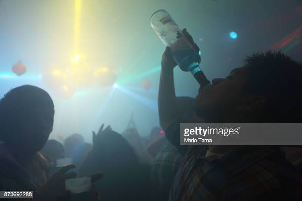 People celebrate at a nightclub in the early morning hours on November 5 2017 in Ushuaia Argentina Ushuaia is situated along the southern edge of...