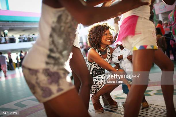 People celebrate at a traditional feijoada party held by the Mangueira samba school one of the most famous in Rio in the Mangueira 'favela' community...