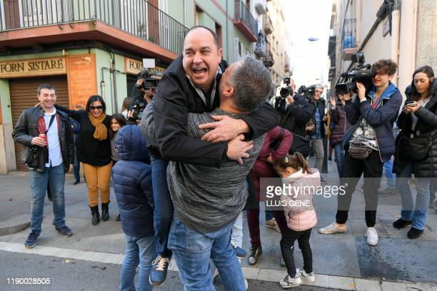 """People celebrate at the Aragones Center """"El Cachirulo"""" after winning the first prize of the draw of Spain's Christmas lottery """"El Gordo"""" in Reus on..."""