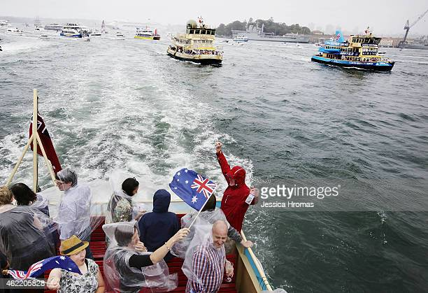 People celebrate Australia Day on one of the Sydney's beloved ferries racing from Circular Quay to Shark Island and back to the finishing post under...