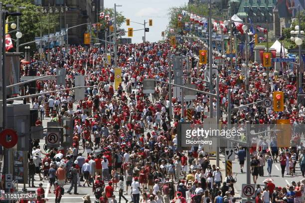 People celebrate Canada Day on Parliament Hill in Ottawa Ontario Canada on Monday July 1 2019 Canada Day celebrates the anniversary of July 1 the...