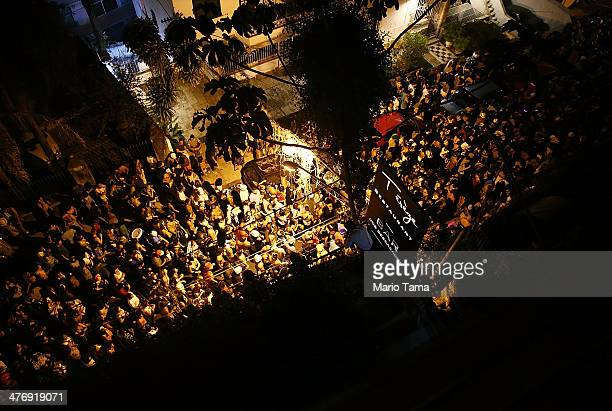 People celebrate during a street carnival bloco in the Santa Teresa neighborhood on March 5 2014 in Rio de Janeiro Brazil While Carnival officially...