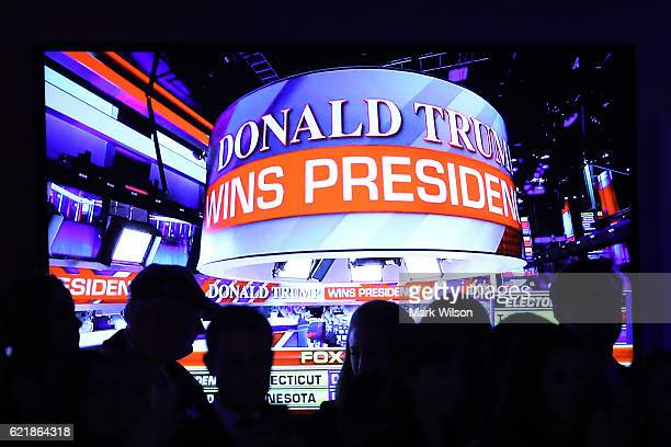 People celebrate during the call for Republican presidentelect Donald Trump at his election night event at the New York Hilton Midtown on November 9...