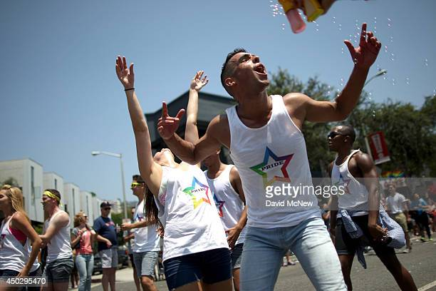 People celebrate during the LA Pride Parade on June 8 2014 in West Hollywood California The LA Pride Parade and weekend events this year are...