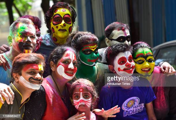 People celebrate festival of colors on occasion of Holi at Shivaji Park on March 10 2020 in Mumbai India