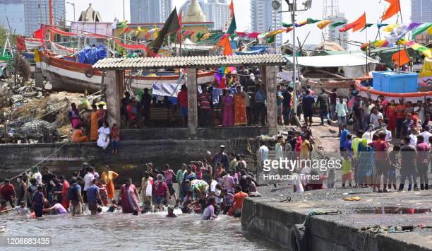 People celebrate festival of colors on occasion of Holi at Worli Koliwada on March 10 2020 in Mumbai India